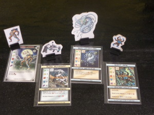 Some of the game pieces and cards